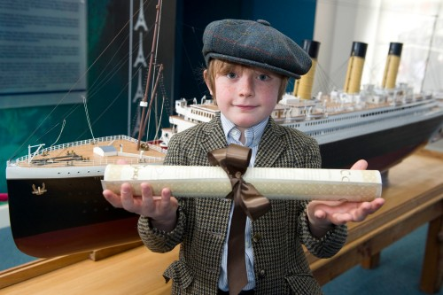 Master Reuben with a model of the Titanic in the Titanic Experience. (Photo: Gerard McCarthy, Thanks to Titanic Experience Cobh)