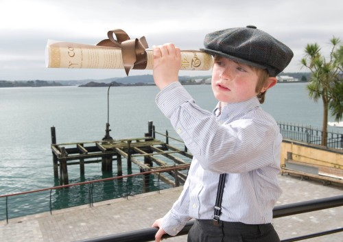 Master Reuben at the back of the James Scott offices. The pier in the background is 'Titanic Pier' where steerage passengers embarked for the Titanic aboard the tender 'America' (Photo: Gerard McCarthy, thanks to Titanic Experience Cobh)